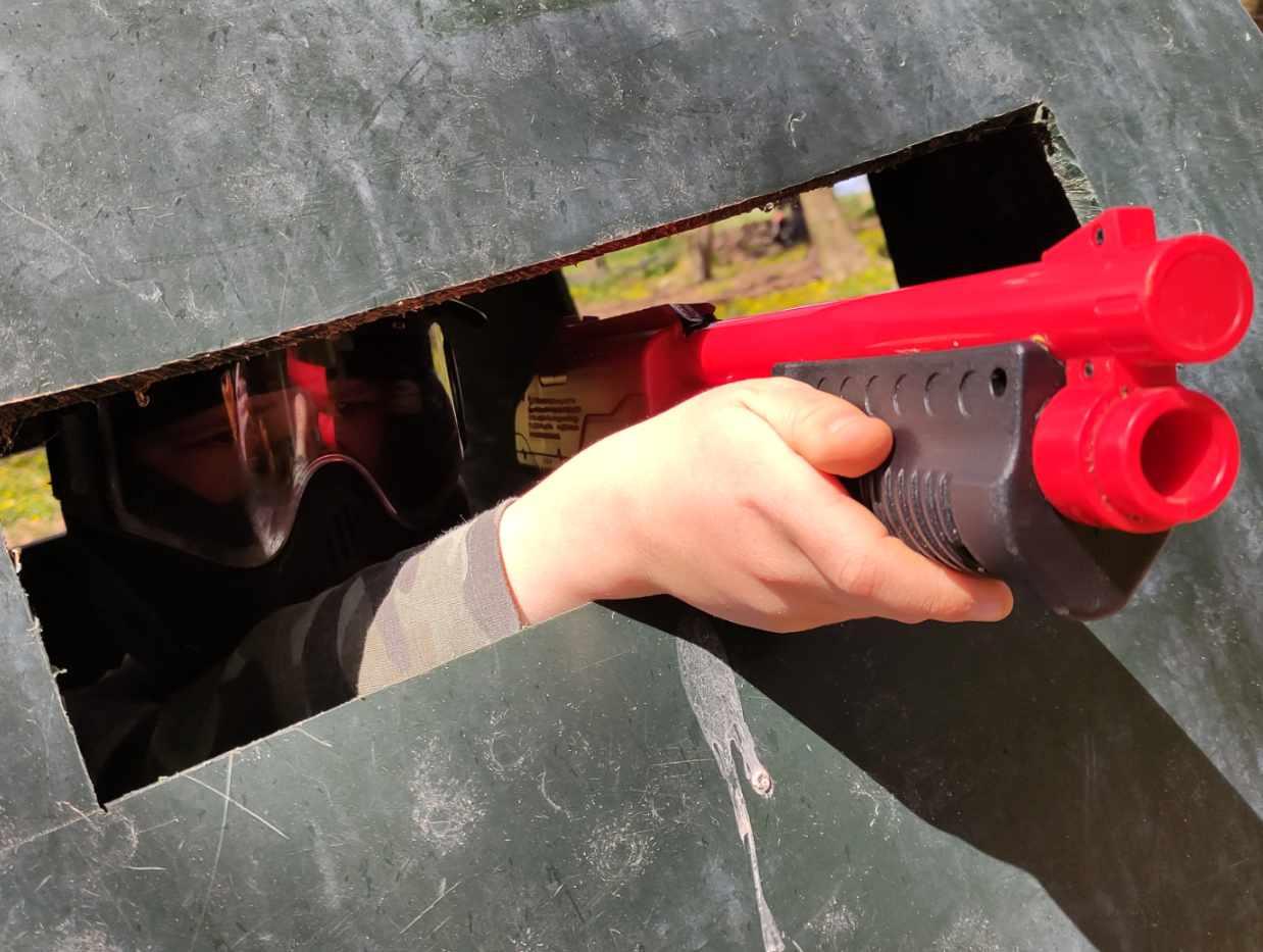 kid firing a splatmaster shotgun from a pillbox slit